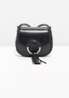 Ring & Tassel Leather Mini-Saddle Bag, 79€